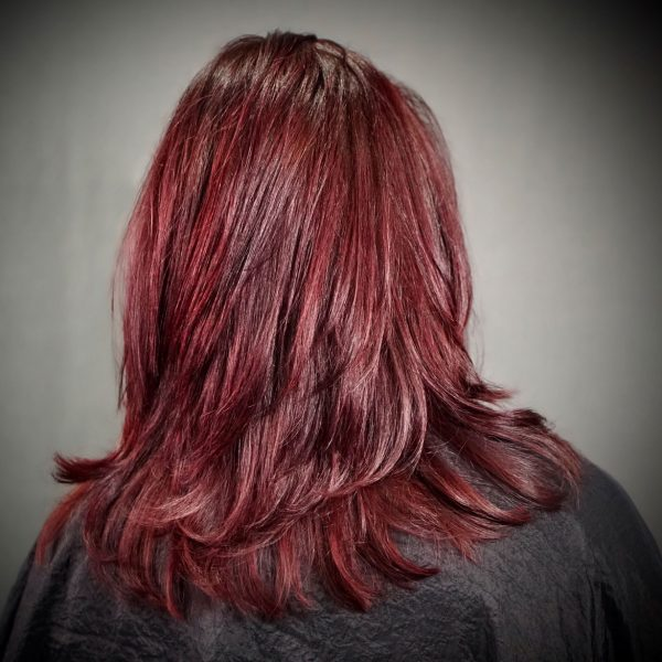 benefits-client-with-long-red-hair